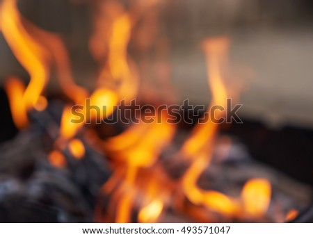 Blurred bright flames. BBQ grill. Hot coal. Burned wood. Blurred bokeh basic background for design