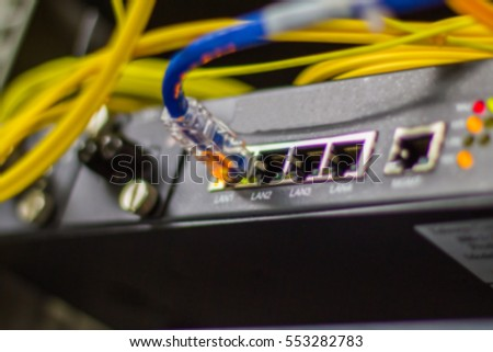 Blurred Fiber optic network  connecting  on core switch  in server room