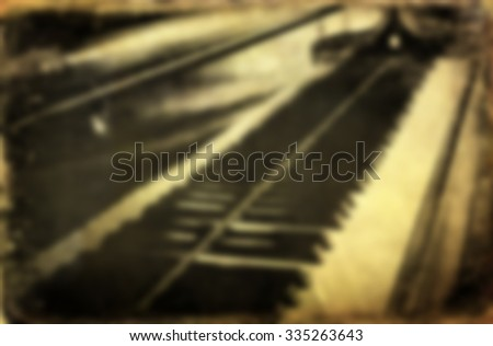 Blurred Grunge piano musical background and added paper texture