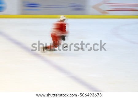 Blurred ice hockey player moving on the ice