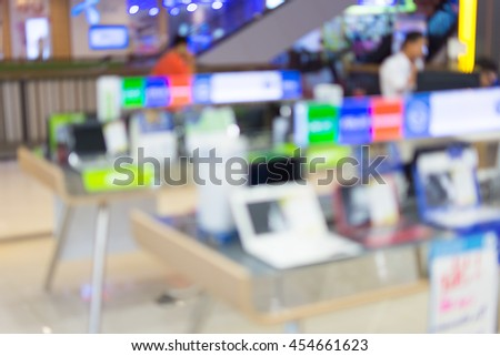 blurred image of laptops in store