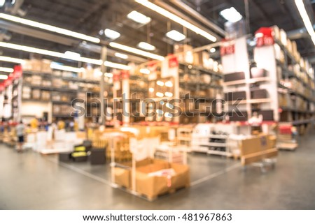 Blurred image large furniture warehouse row stock photo for Furniture w sale warehouse
