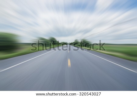 blurred motion rides along the country road  fast  logistics