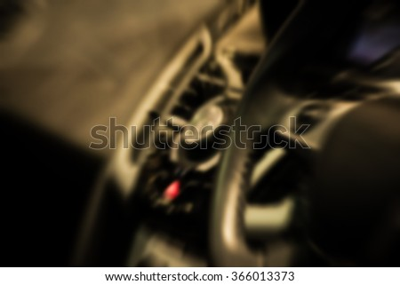 Blurred of Zoom at sports car console with steering wheel in Car show event at Bangkok, Thailand.  Vintage style.