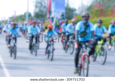 blurred people cycling together in the event BIKE FOR MOM