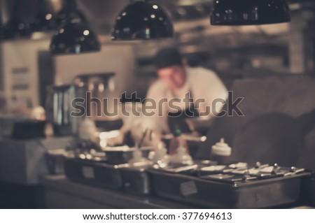 Restaurant Kitchen Photography blurred restaurant chef chef cooking open stock photo 377694613