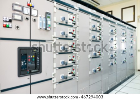 Blurry electrical control panel in central control room of power plant