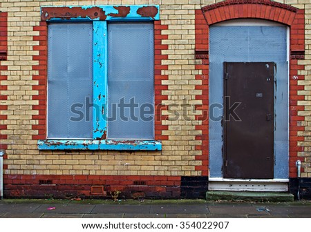 Boarded up houses awaiting regeneration in Liverpool UK.