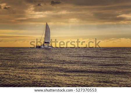Boat sailing on the ocean near Mauritius at sunset
