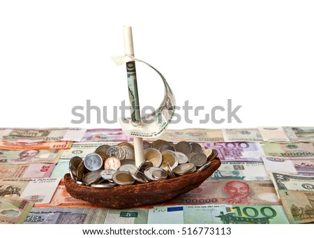 Boat with coins on background of banknotes of different countries