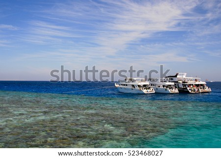 Boats and coral reef