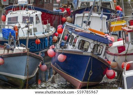 Boats at low tide in the harbor of Mevagissey,Cornwall,England