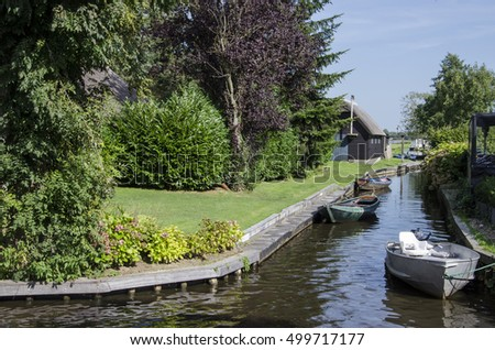 Boats parked in a canal in Giethoorn