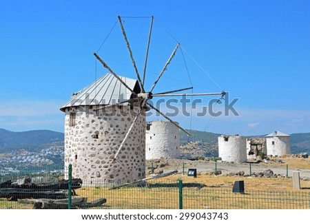 BODRUM, TURKEY â?? JULY 2 2015: Windmills stand on the hill in Bodrum and were used from eighteenth century to 1960s as a means to grind flour for the local people.