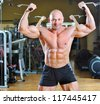 Bodybuilder posing at gym - strong man torso - stock photo