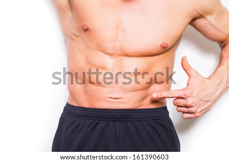 Bodybuilder posing on white background.