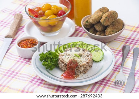 Boiled buckwheat with cheese, tomato sauce and pork cutlets