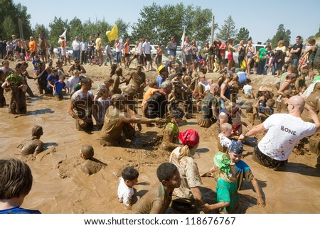 BOISE, IDAHO - AUGUST 25: People play in the pond of mud at the Dirty Dash August 25 2012 in Boise, Idaho