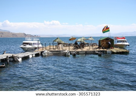 BOLIVIA, TITICACA LAKE, 13 SEPTEMBER 2013 - Tourist Boats at floating island on Titicaca lake in Bolivia, South America