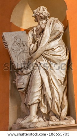 BOLOGNA, ITALY - MARCH 15, 2014: Baroque statue of Saint Luke the Evangelist from west portal of church Chiesa della Madonna di San Luca.