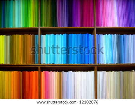 Bolts of colored cotton arranged on display in a fabric shop in Delhi, India