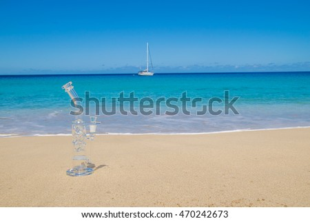 Bong on the sand and boat