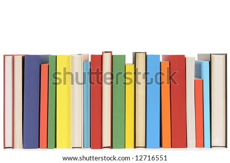Book row : neat row of colorful books isolated on white background.
