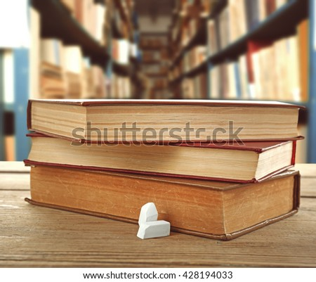 Books on desk in library. School concept