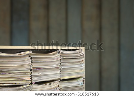 Books on wooden shelves with old wooden walls.