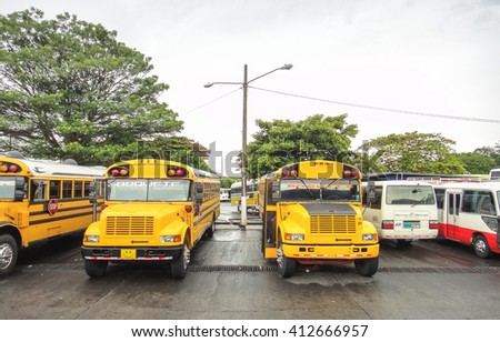 BOQUETE/PANAMA - OCTOBER 2 2014: Yellow school buses in Boquete. Blue Bird Corporation. IC Bus. Thomas Built Buses, Inc.