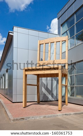BOROVICHI, RUSSIA - JULY 20: Giant chair near the factory Borovichy-Furniture on July 20, 2011 in Borovichi, Russia. Borovichi, a town of oblast significance in Novgorod region