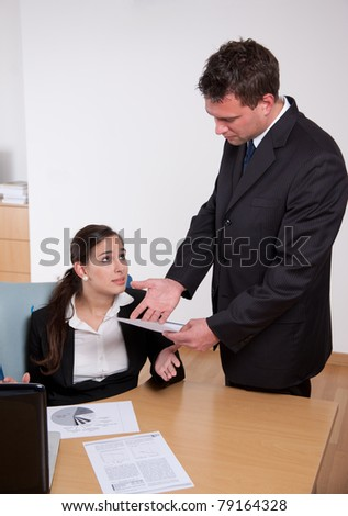 Boss showing dissatisfaction with his secretary's work
