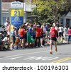BOSTON - APRIL 16 : Nearly 25000 runners participated in the Boston Marathon on a record hot day of 87 F on April 16, 2012 in Boston.  Wesley Korir (Kenya) finished first with a time of 2:12:40. - stock photo