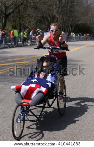 BOSTON - APRIL 18: Team Hoyt  runs in their 33rd marathon up Heartbreak Hill during the Boston Marathon April 18, 2016 in Boston.[public race]