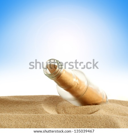 bottle and sand
