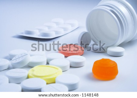 Bottle of pills mixed with sweets.Concept - Keep out of reach of children.