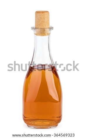Bottle with apple vinegar  isolated on the white background