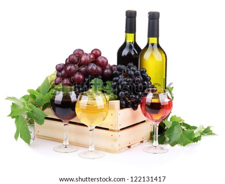 bottles and glasses of wine and assortment of grapes in wooden crate, isolated on white