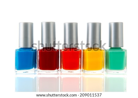 Bottles colorful nail polisch isolated over white background
