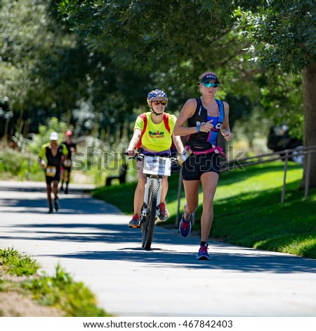 Boulder, Colorado, USA - August 7, 2016: Lectie Altman leads the run at Ironman Boulder.