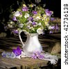 bouquet of bluebells and daisies in a white jug - stock photo