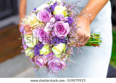 Bouquet of flowers in bridals hand