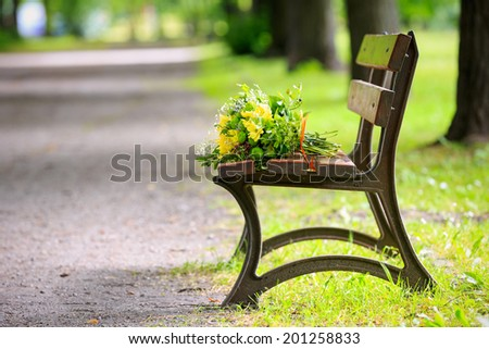 Bouquet of flowers on a bench in the park in spring