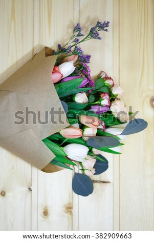 bouquet of flowers on a wooden background