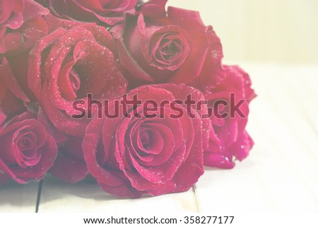 Bouquet of red roses on a wooden background with Soft tone