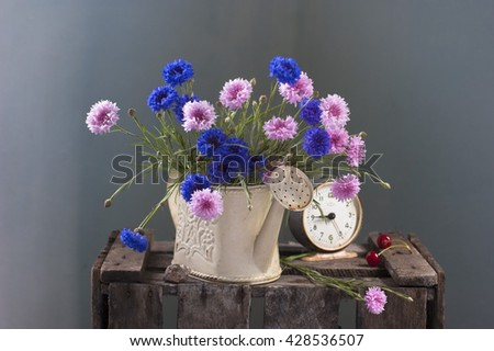 bouquet with blue and pink cornflowers