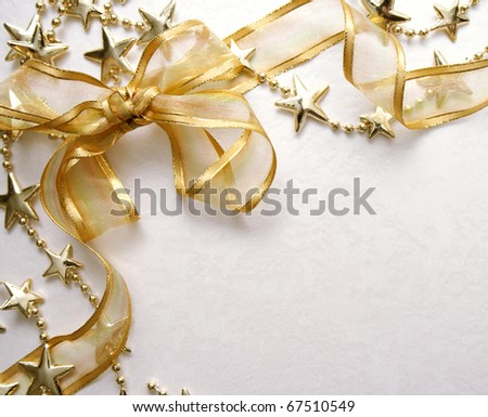 bow of gold satin ribbon on paper. Natural texture