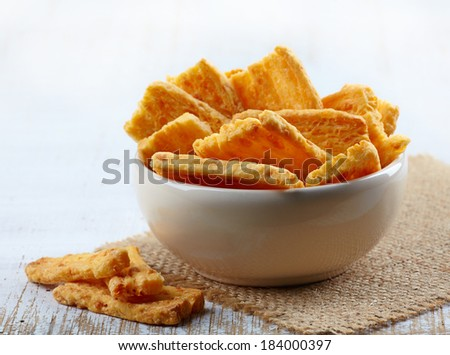 Bowl of Cheese cookies on a wooden table