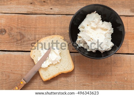 Bowl of cream cheese and fresh bread