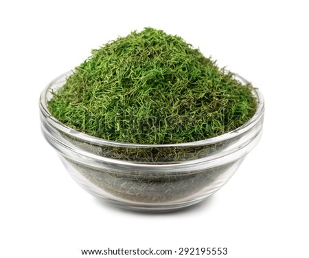 Bowl of dried dill weed isolated on white